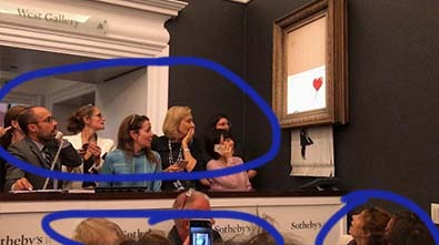 Surprised faces as Banksy's piece is shredded live at auction